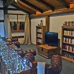 TV mezzanine room with flat screen TV, selection of DVD'S, books and games