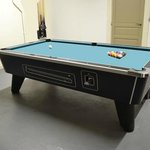 Games room with full size American pool table and a dart board