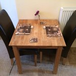 Perfect for romantic meals together, our cute little dining table
