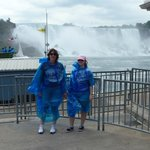 Me and my Mum in front of the falls, wearing what you have to wear.