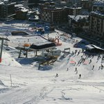 View of chairlifts and village
