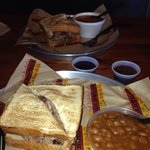 Pork sandwich with side. Got baked beans & Brunswick stew. 4 varieties of BBQ sauce at the pump