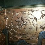 Copper leafed plaster design on wall. Beautiful!