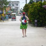 The Mrs. wandering the streets of Caye Caulker.
