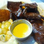 Anticuchos - Marinated beef heart served with fried potato, Peruvian corn and mild aji dip.