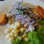 Ceviche de pescado - lemon-cooked white fish with onions and cilantro, served with yams and peru
