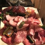 Assortment of meats accompanying the Raclette au Lait
