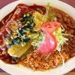 Veggie enchiladas - spinach, corn, mushrooms, corn and onion, smothered with red and or green ch
