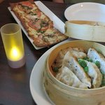 Wood fired flatbread and pork dumpling appetizers