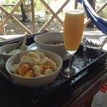 Breakfast - fruit with yoghurt and fresh orange juice