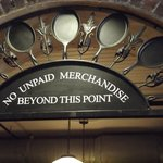 Sign above store arch leading to restaurant