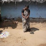 Young village girl making a Kolam for us