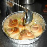 Hot garlic rolls served with special garlic sauce
