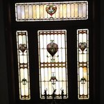 Stained glass window in stairway.  Always used in the homes of the architect.  J. B. Legg.