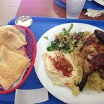 chicken dish with side of white pita bread