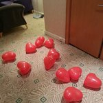 Heart shape baloons in entrance to room