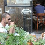 See patrons and their pooch, enjoying the bistro