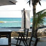 The ocean from the seating are of the beach bar