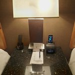 A clock radio/alarm/iPhone charger (pre-iPhone5) on the bedside table