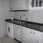 Clean kitchen with washing machine