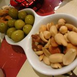 This is a complimentary: olive, nuts and fried pasta were first of all served.