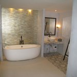 large bathrrom with tub and shower