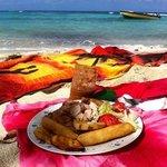 Beach lunch. Jerk Chicken, festival, fried plantain. Delicious.