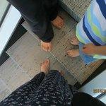 bare feet on elevator