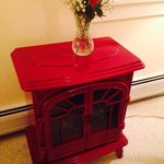 Roses on the decorative stove in Apple Blossom room for valentine's day weekend