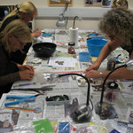 Students working on the glass fusing class