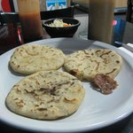 A trio of pupusas hot off the grill