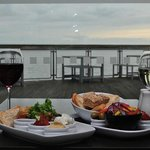 Enjoy a glass of wine and a sharing platter