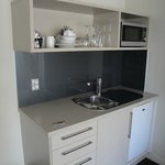 Convenient kitchenette with fridge and microwave