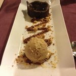 Chocolate cake with salted caramel, ice cream and popping candy