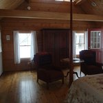 Sitting area in Three Sisters cabin with storage armoire