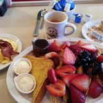 French toast and berries plater, eggs and bacon included