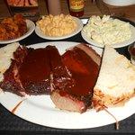 Brisket, pork ribs, sweet potatoes, potato salad, and mac & cheese platter.