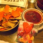 Salsa, colored tortilla chips, candies for Valentine's Day.