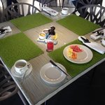 Restaurant for breakfast. Faux grass placemats!