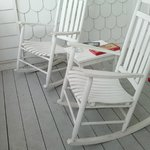 nice rocking chairs on mold-covered balcony