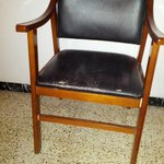 Chair in the room with the faux leather cracked