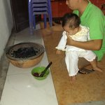 Lam and his baby fixing BBQ