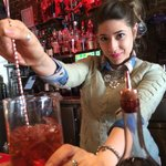 Stirring up a delicious Negroni!