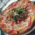 Beef carpaccio pizza + horseradish aioli drizzle