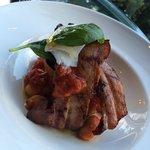 Braised pork belly served with stewed Italian white bean + Roma tomato + bufala mozzarella