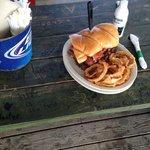 That is a regular size beer bottle next to that brisket sandwich!