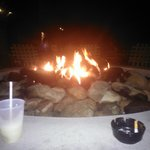 gas fire pit at Harrys at night