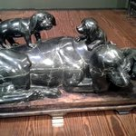 dog with puppies sculpture
