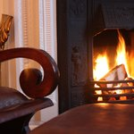 Log fire in the guest sitting room.
