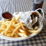 Delicious Gyro with crispy fries and a cold Pepsi